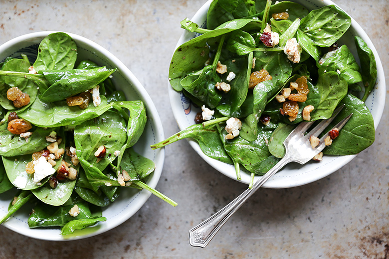 Wilted Spinach Salad with Hazelnuts, Goat Cheese and Raisins