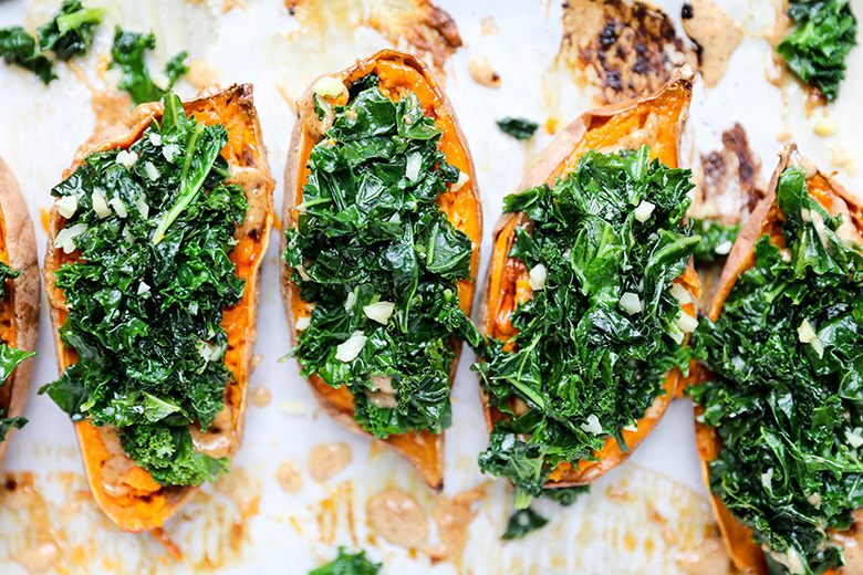 Baked Sweet Potatoes with Garlicky Kale and Almond Butter